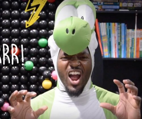 Martellus Bennett dresses as dinosaur, Santa Claus to inspire passion for young readers