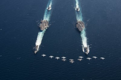 Truman, Lincoln strike groups train together in western Atlantic Ocean