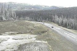 Summer snow creates wintry scenes around Yellowstone