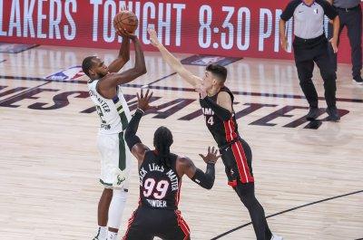 Khris Middleton leads short-handed Bucks over Heat to avoid sweep