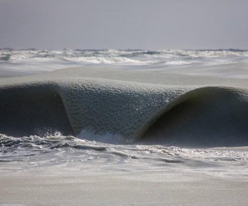 Photographer captures 'Slurpee' waves in Massachusetts