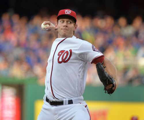 Washington Nationals RHP Stephen Strasburg tosses briefly on flat ground