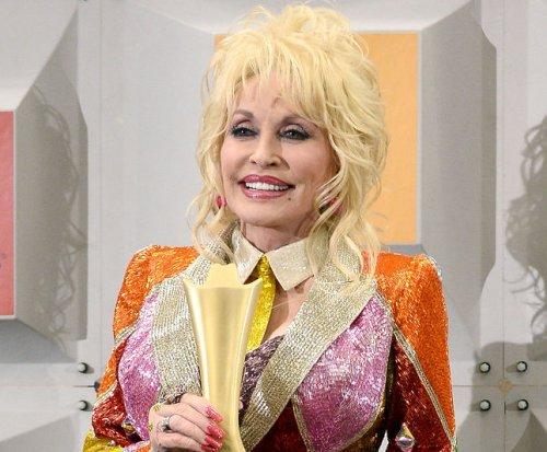 Dolly Parton donates 100 millionth book through her non-profit