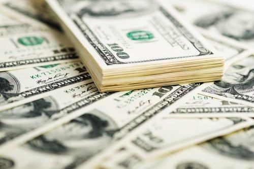 Optimistic Fed stops buying bonds to aid economy