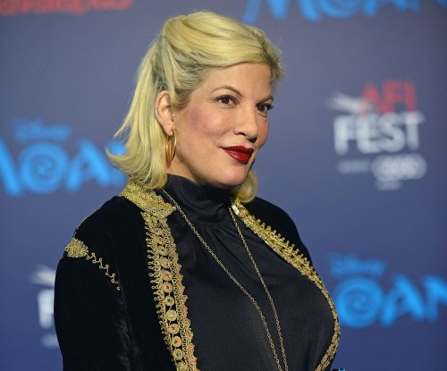 Tori Spelling shows off baby bump at star-studded 'Moana' premiere