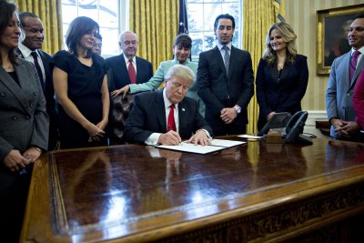 Trump signs executive order to cut regulations on businesses
