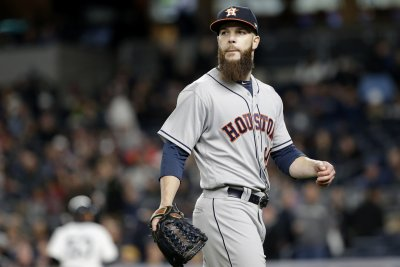 Houston Astros escape Oakland A's behind arm of Dallas Keuchel