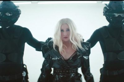 Christina Aguilera, Demi Lovato break free in 'Fall in Line' music video