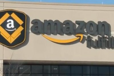 Amazon slashing worker bonuses, stock awards to raise wage to $15
