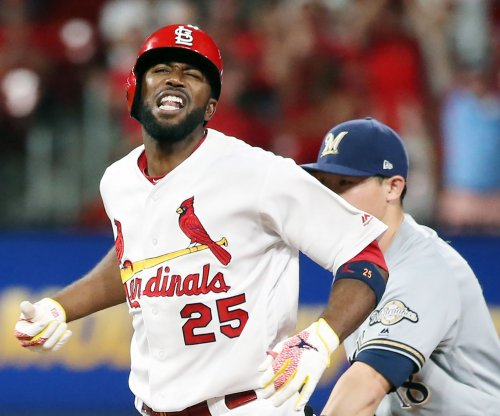 Cardinals beat Rockies with trio of two-run homers