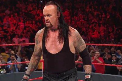 WWE Raw: The Undertaker saves Roman Reigns