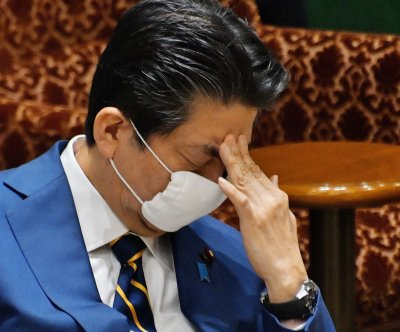 Shinzo Abe's approval rating slides amid coronavirus, prosecution scandal