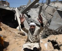 Israeli airstrikes kill 33 in Gaza City, including 2 young children