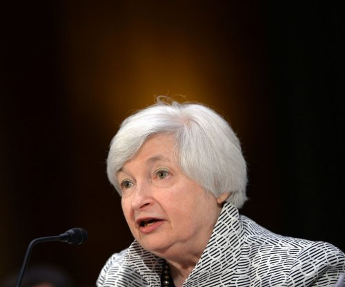 Stock prices jump after Fed promises caution on interest rate hike