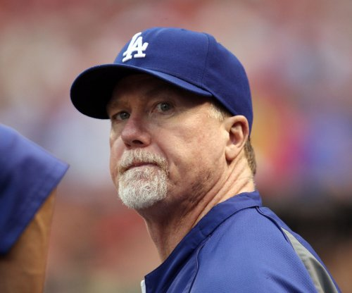 Padres hire Mark McGwire as bench coach