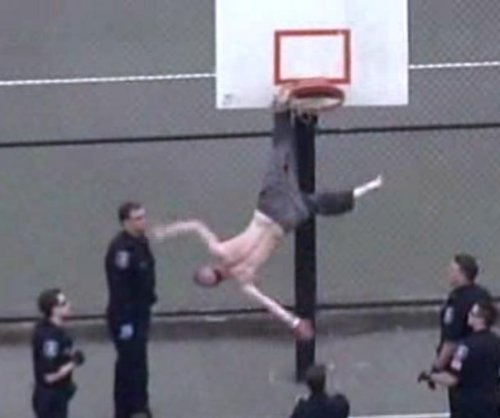 Shirtless, hammer-wielding man rescued from Seattle basketball hoop