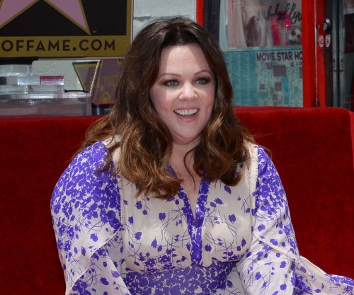 Melissa McCarthy wears own dress design to 'Spy' premiere