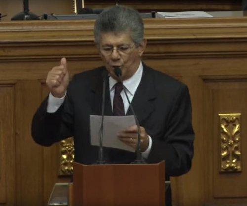 Venezuela's legislature swears in suspended members, bucking Maduro and court