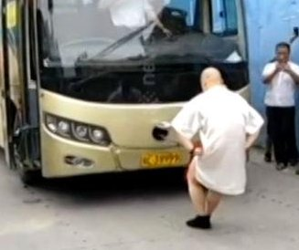 Kung fu master uses genitals to pull bus down street