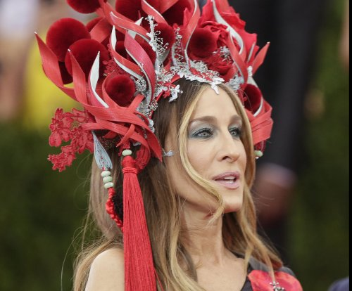 Sarah Jessica Parker wears large fiery headdress to the Met Gala