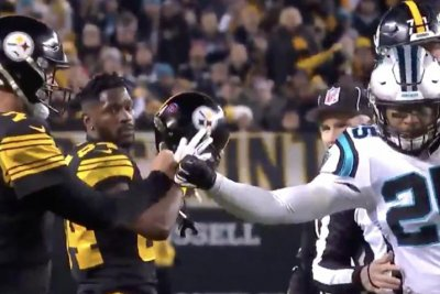 Panthers' Reid ejected for Roethlisberger hit, gives QB first bump