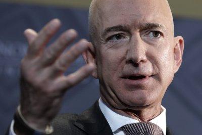 Amazon's Bezos, Walmart's Bartlett trade jabs over wage hike