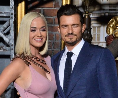 Katy Perry says Orlando Bloom's son helped her mature