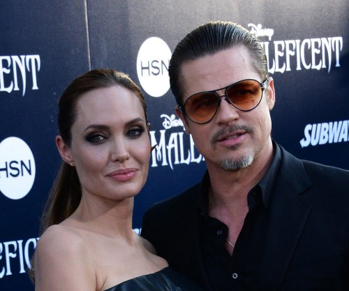 Brad Pitt, Angelina Jolie cozy up at 'By the Sea' screening