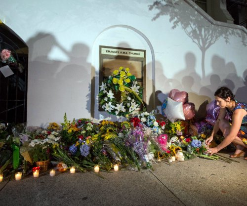 Friend of accused Charleston massacre shooter pleads guilty