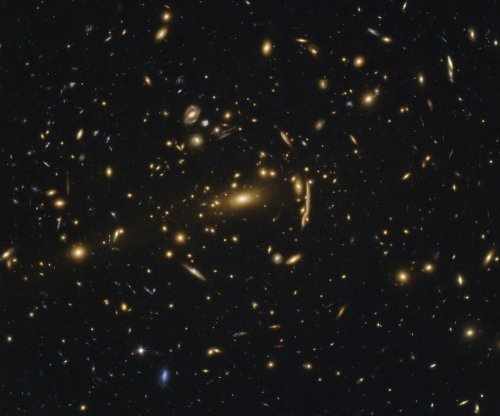 Astronomers discover new law of galaxy cluster evolution