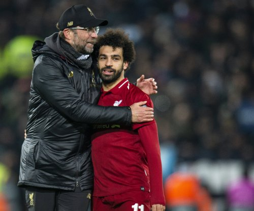 Mohamed Salah pushes Liverpool into Champions League final 16