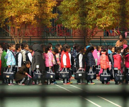 Man arrested after injuring 20 children in Beijing 'hammer' attack