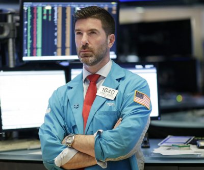 Dow sinks 879 points amid growing coronavirus fears