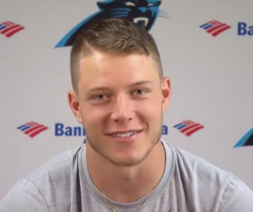 Carolina Panthers rookie RB Christian McCaffrey relentlessly jukes LB Luke Kuechly