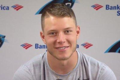 Carolina Panthers rookie RB Christian McCaffrey relentlessly jukes LB Luke Kuechly