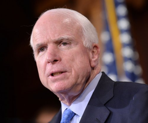 John McCain websites give differing views in different languages