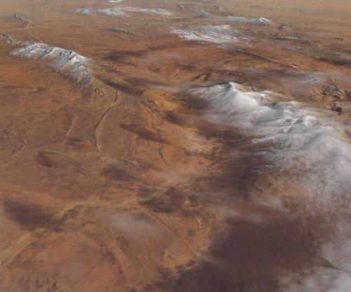 NAS satellite image features snow-covered desert dunes