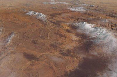 NAS satellite image features snow-covered desert dunes
