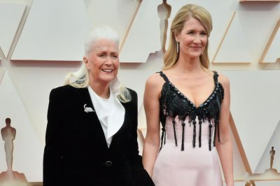 Laura Dern, Keanu Reeves, Charlize Theron bring moms to Oscars