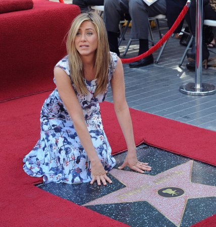 Aniston: Theroux sneaky about engagement