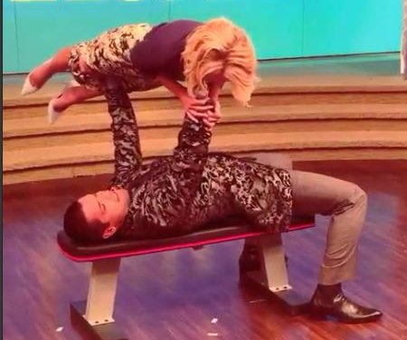 Watch Mark Consuelos bench-press wife Kelly Ripa
