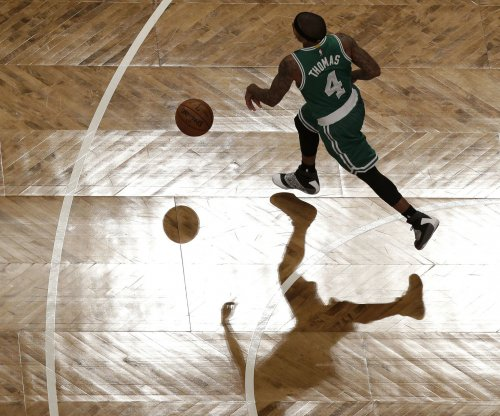 Isaiah Thomas' 34 points guides the Boston Celtics past the Portland Trail Blazers
