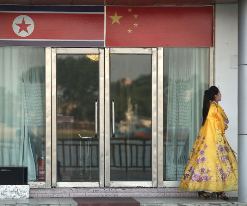 China orders shutdown of North Korea entities, joint ventures