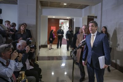 Michael Cohen begins 3-year federal prison term