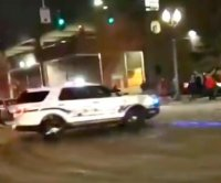 One person injured after Tacoma police officer drives vehicle through crowd