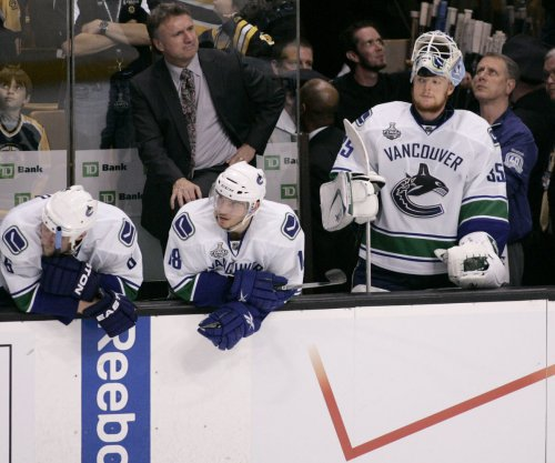 Chris Tanev's OT goal lifts Vancouver Canucks past Calgary Flames