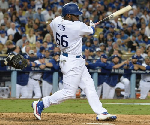 Yasiel Puig keys power surge as Los Angeles Dodgers rout Cincinnati Reds