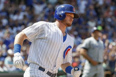 Ian Happ's two HRs help Chicago Cubs top Cincinnati Reds in series finale