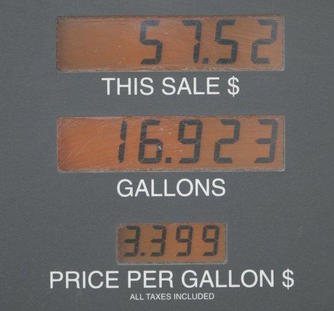 Crude oil slides under $99