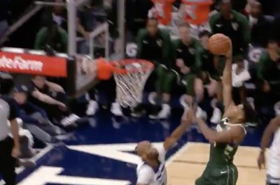 Giannis Antetokounmpo treats Taj Gibson to poster dunk